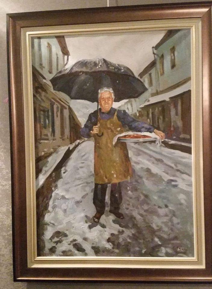 Vasil Bakalli në Tablonë e Piktorit të Njohur Edi Kojani- Gati Lakrori i Pjekur në Furrën e Premtos në Qafë të Pazarit të Gjirokastrës për Darkën e Vitit të Ri!